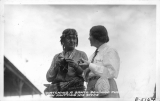 Mrs. Josephine Frasher watching a Santo Domingo Pueblo Indian knitting his Socks