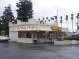 Manna Donuts, 600 E Holt Ave. Public parking lot.